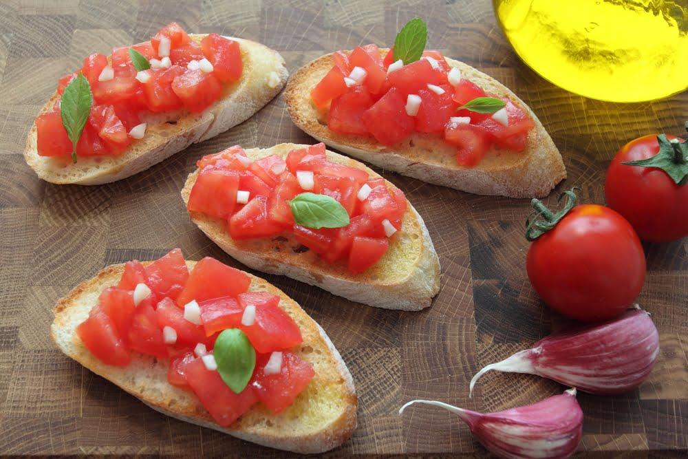 Bruschetta with tomato, rocket and garlic