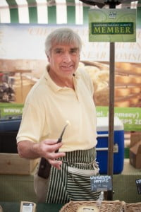 Mike Smales of Lyburn Farmhouse offering samples of Award Winning Cheeses at Hampshire Farmers' Markets