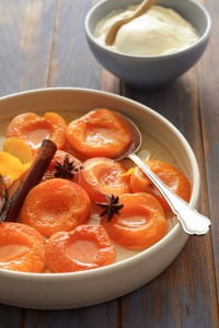 Poached apricots with orange blossom. Caroline Velik STONE FRUIT recipes for Epicure and Good Living. Photographed by Marina Oliphant. Food preparation and styling by Caroline Velik, plate from Essential Ingredient, MUST CREDIT.